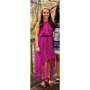 Women's high-low purple, high neck, flowy dress.